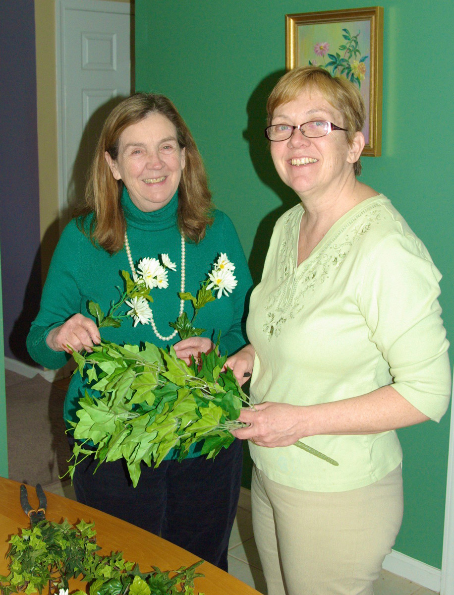 Ivy and Daisy Chain. Phyllis Egan Beals, Smith 1978, and sister, Beth, cut up plastic flowers.