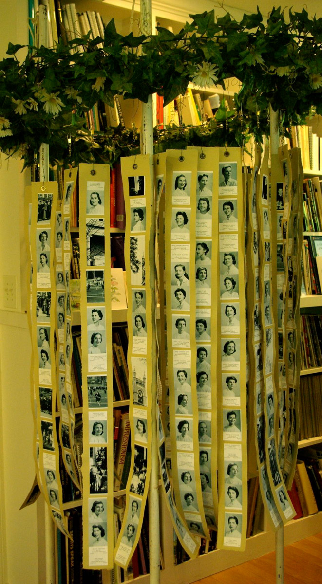 Testing. Armature suspended on poles, with 600 classmates photos in place, alphabetically.