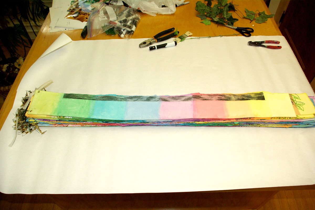 """Transporting """"Circle of Life."""" Wrapping the number-ordered, rainbow strips."""
